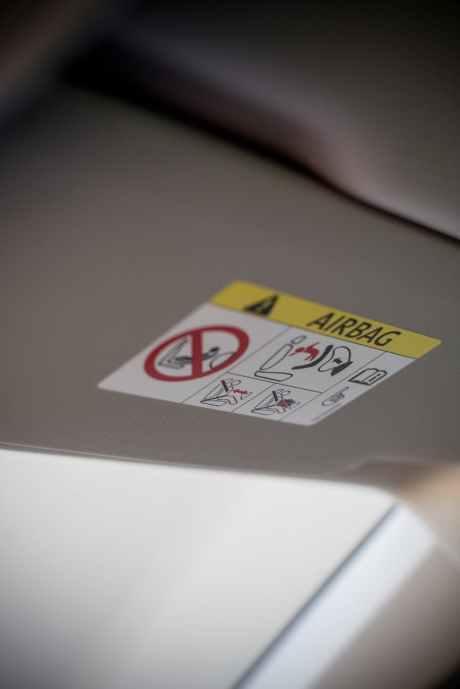 white airbag instruction label